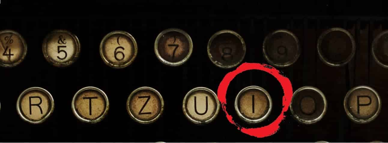 Old retro typewriter with the I key circled in red